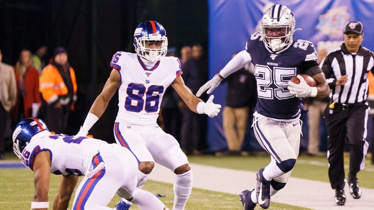 FILE - Cowboys free safety Xavier Woods (25) returns an interception on a pass intended for Giants wide receiver Darius Slayton (86) during the first half of a game on Monday, Nov. 4, 2019, in East Rutherford, N.J.