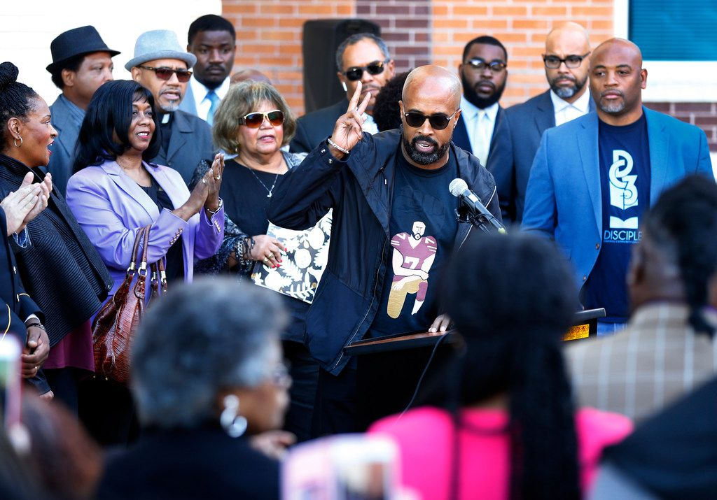 Dr. Frederick D. Haynes III flashes the peace sign after speaking before several other ecumenical and community leaders. They were outspoken about the recent controversies surrounding NFL quarterback Colin Kaepernick and the freedom to take a knee during the national anthem. (Tom Fox/Staff Photographer)