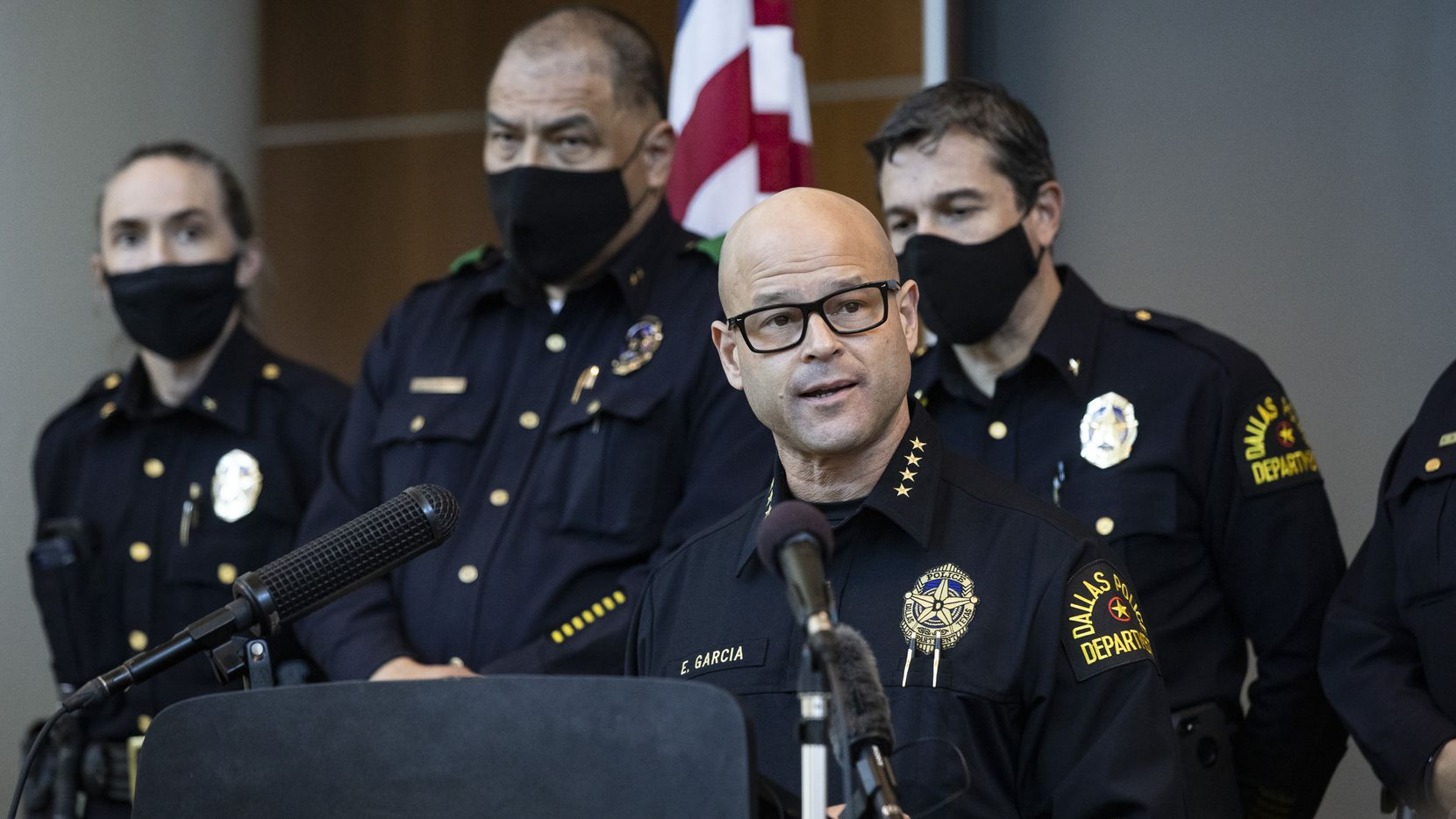 Chief Eddie García (center) speaks with media during a press conference regarding the arrest and capital murder charges against Officer Bryan Riser at the Dallas Police Department headquarters on Thursday, March 4, 2021, in Dallas.  (Lynda M. González/The Dallas Morning News)