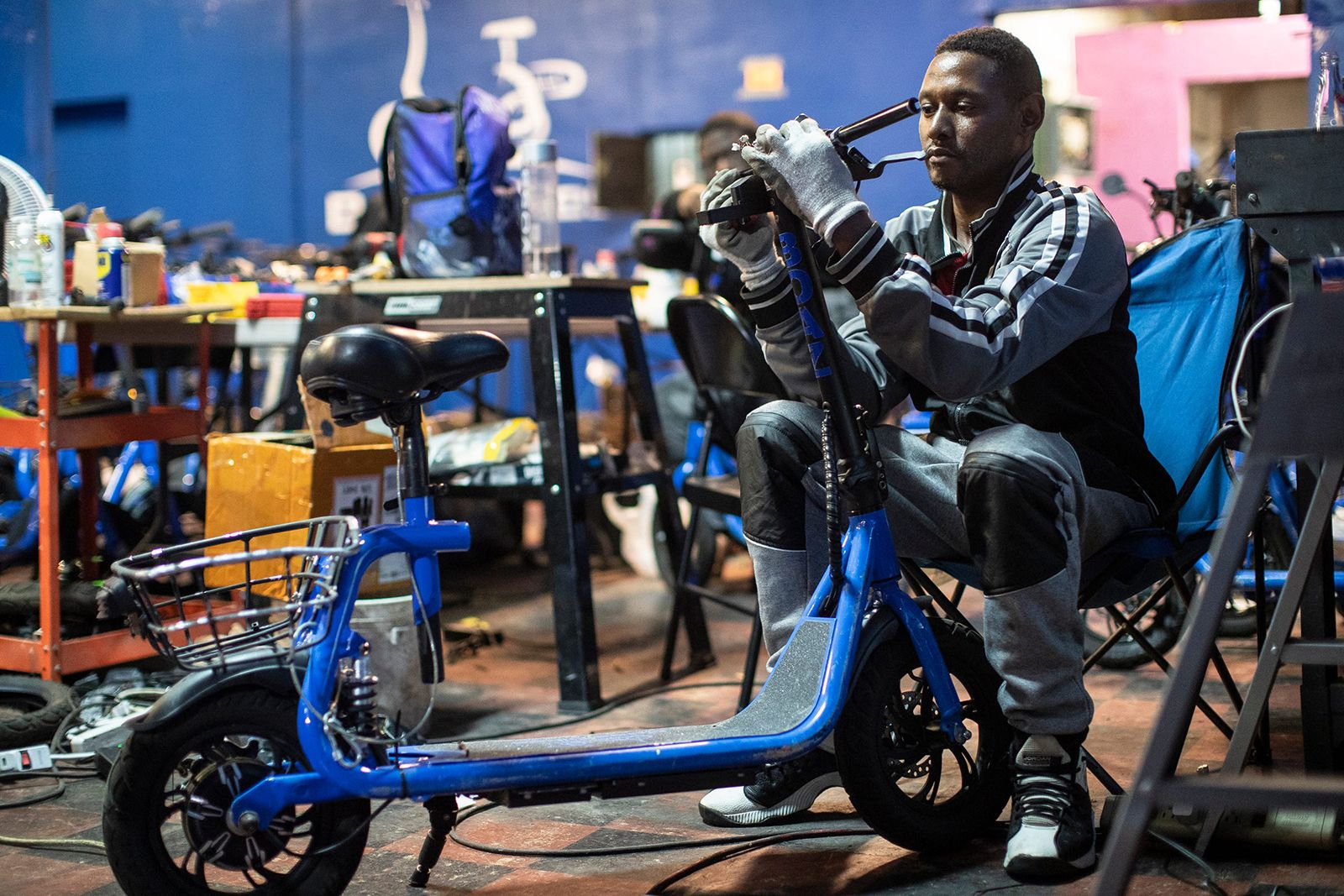 Boaz Bikes lead mechanic Joei Wilson repairs a bike at the company's facility in Detroit.