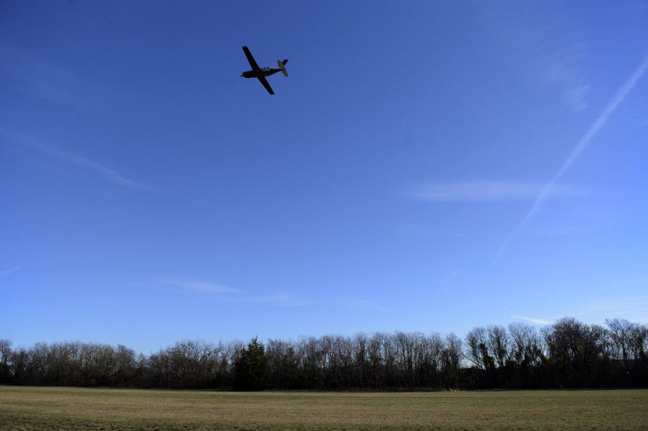 A plane takes off over the grass portion of the runway at Aero Country Airport in McKinney, Texas on Dec. 16, 2014. (Rose Baca/The Dallas Morning News)