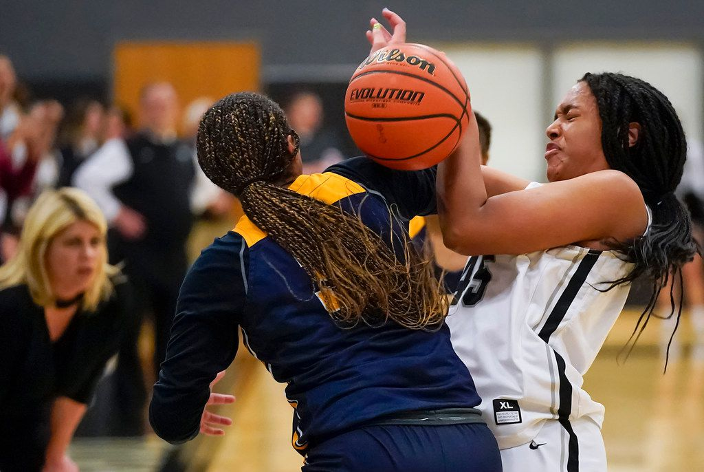 Bishop Lynch Victoria Jordan (45) knocks the ball away from Prestonwood Christian guard Jordan Webster (32) during a TAPPS 2-6A high school girls basketball game on Friday, Feb. 7, 2020, in Dallas. Bishop Lynch won the game 59-54. (Smiley N. Pool/The Dallas Morning News)
