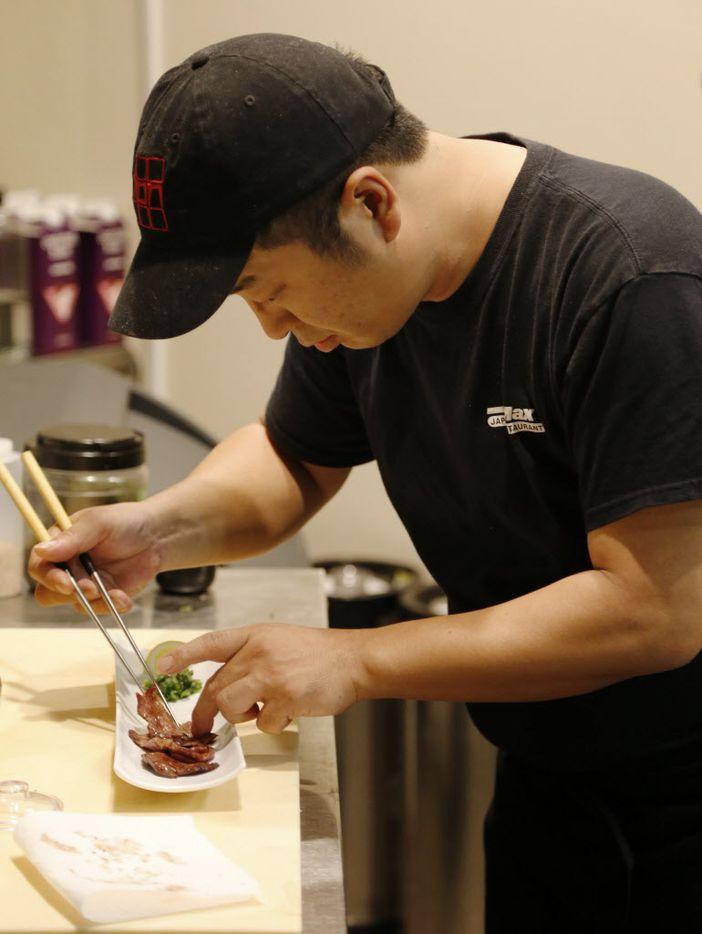 Masato Sato, Mr. Max's manager,  prepares a dish.