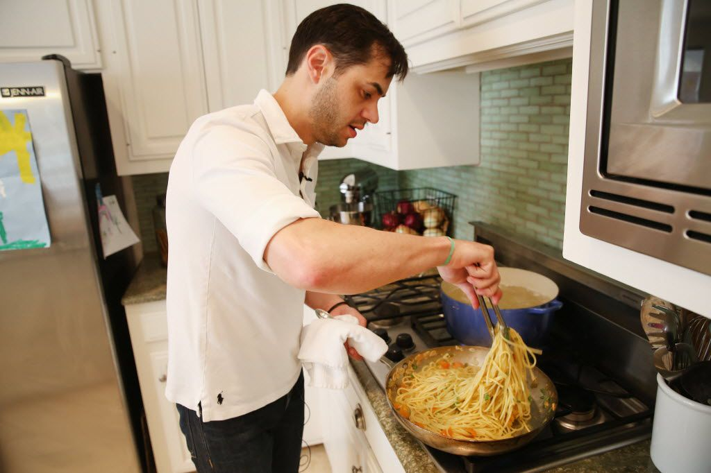 Chef Julian Barsotti, of Nonna, Carbone's Fine Food and Wine and Sprezza, demonstrates a method of finishing pasta in a pan at his Dallas home Thursday June 16, 2016. The dish includes pickled jalapeno, sun gold cherry tomatoes, garlic, pasta, basil and ricotta salata. (Andy Jacobsohn/The Dallas Morning News)