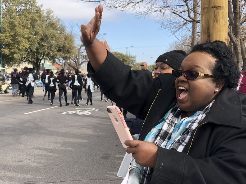 Anita Coleman cheers on her daughter Kimberlyn as she drives through in the parade. Kimberlyn Coleman was recognized for winning the 12th grade essay contest, put on by the Martin Luther King Jr. Community Center.