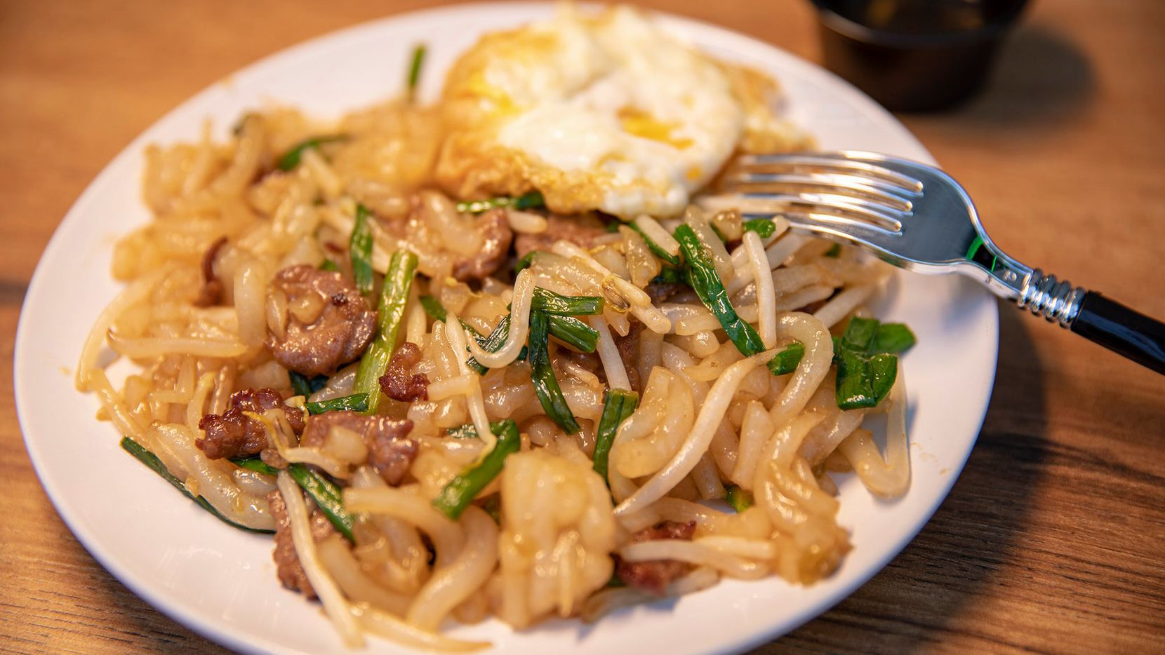 Lort cha is a popular Cambodian dish served at Aspara Thai and Cambodian restaurant.