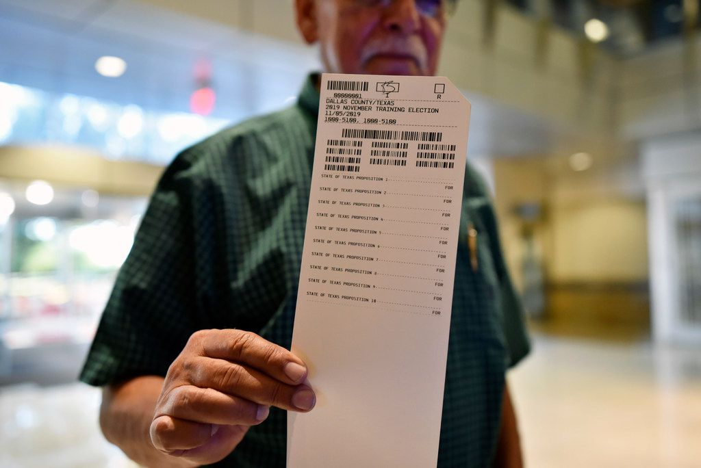 Ron Abraham, 75, of Mesquite, shows off his printed ballot before scanning his votes during a demonstration of the new equipment for elections, Sept. 25 at City Hall in Mesquite. Starting this Fall, Dallas voters will use the new equipment as well as visit voter centers to cast their ballot and not the precincts they're used to.