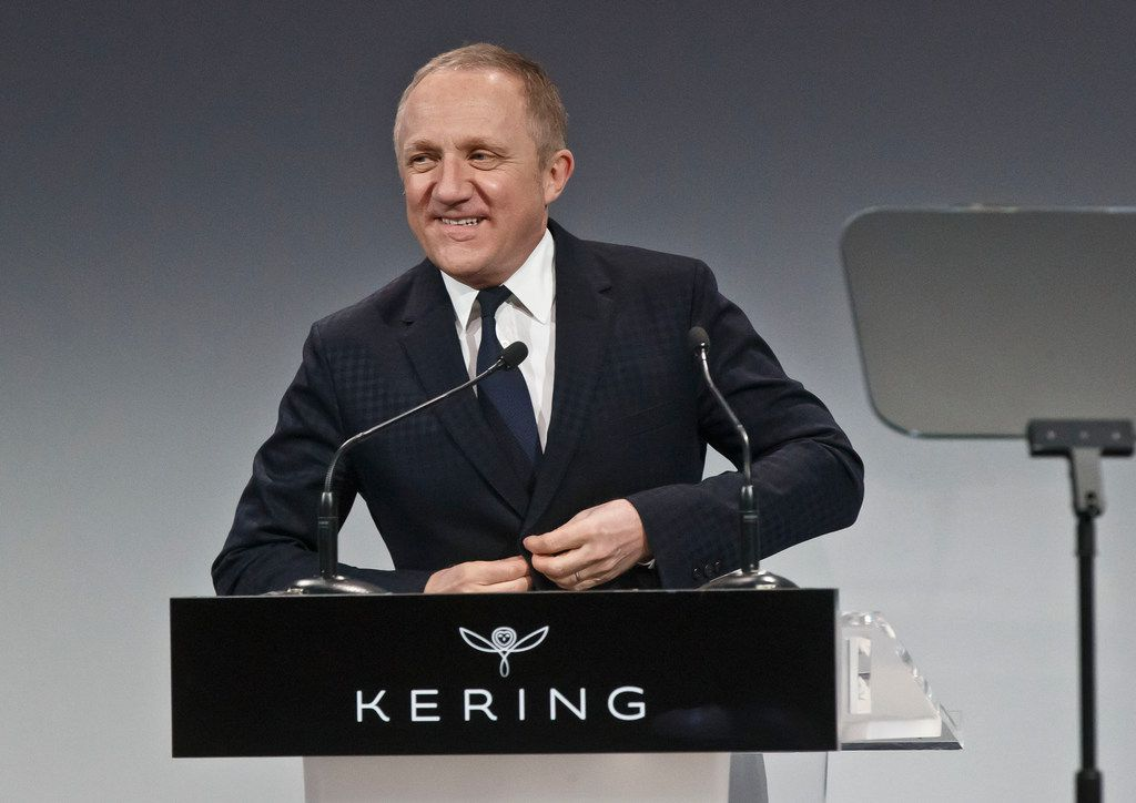 "FILE - In this Friday, Feb. 19, 2016 file photo luxury group Kering CEO Francois-Henri Pinault adjusts his jacket as he speaks to the media during the full year 2015 results presentation in Paris. Businessman Francois-Henri Pinault and his billionaire father Francois Pinault said they were immediately giving 100 million euros from their company, Artemis, to help finance repairs to fire damaged Notre Dame cathedral. A statement from Francois-Henri Pinault said ""this tragedy impacts all French people"" and ""everyone wants to restore life as quickly as possible to this jewel of our heritage.""(AP Photo/Michel Euler, File)"