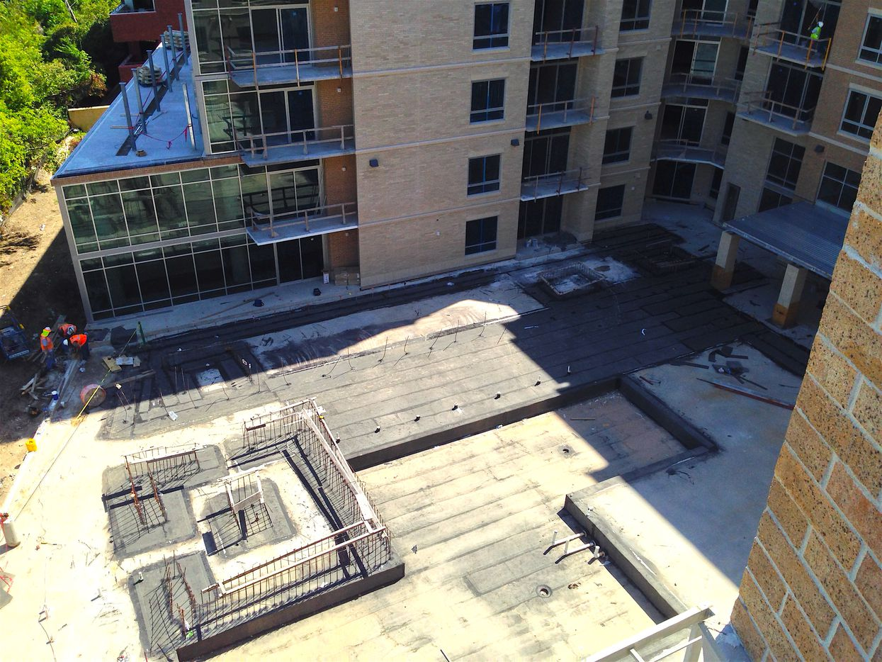The swimming pool still under construction at The Katy apartments is adjacent to the Katy Trail.