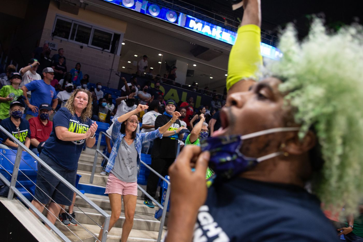 Fans celebrate a basket for Dallas Wings during their game against NY Liberty at College Park Center in Arlington, TX on September 11, 2021.  (Shelby Tauber/Special Contributor)