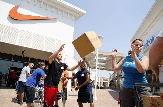 Workers stocked the Nike store at Paragon Outlets in Grand Prairie as it prepared to open.