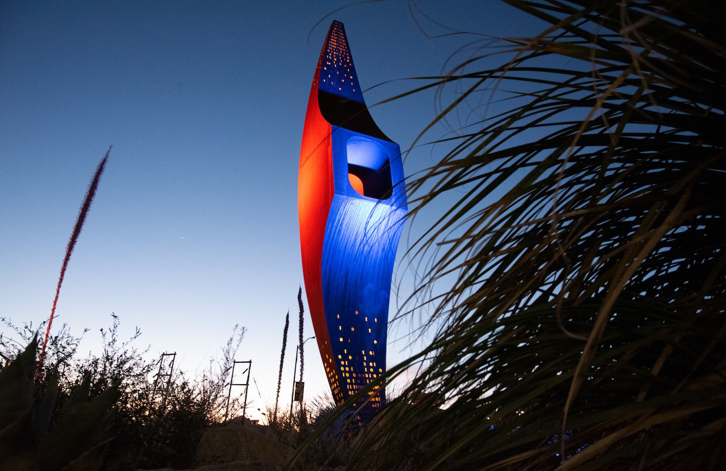 "In a move to commemorate the class of 2020 and celebrate education, the University of Texas at El Paso lit the ""Mining Minds"" pick axe sculpture blue and orange."