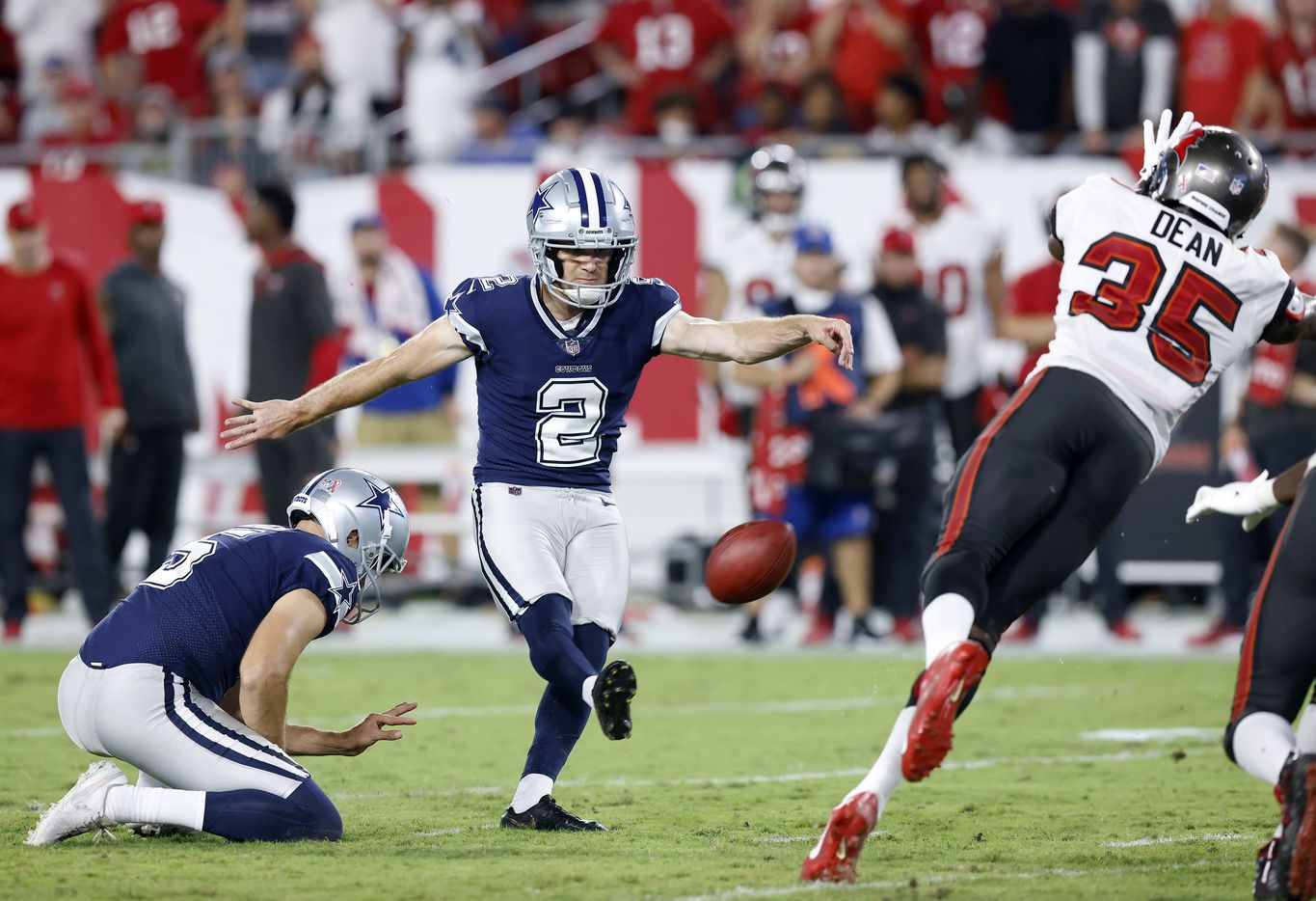 Dallas Cowboys place kicker Greg Zuerlein (2) kicks the go-ahead field late in the fourth quarter as Tampa Bay Buccaneers cornerback Jamel Dean (35) makes a diving block attempt at Raymond James Stadium in Tampa, Florida, Thursday, September 9, 2021. The Buccaneers would later kick the winning field goal to win the game. The Cowboys faced the Tampa Bay Buccaneers in the NFL season opener. (Tom Fox/The Dallas Morning News)