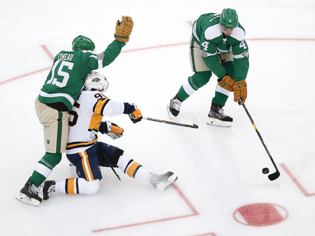 Dallas Stars defenseman Miro Heiskanen (4) takes control of the puck past Nashville Predators center Matt Duchene (95) as Dallas Stars left wing Blake Comeau (15) works to provide cover during the first period of a NHL Winter Classic matchup between the Dallas Stars and the Nashville Predators on Wednesday, January 1, 2020 at Cotton Bowl Stadium in Dallas. (Ryan Michalesko/The Dallas Morning News)
