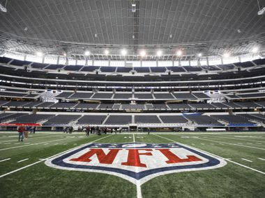 The NFL logo, painted at mid field on January  27,  2011 at Cowboys Stadium in Arlington.