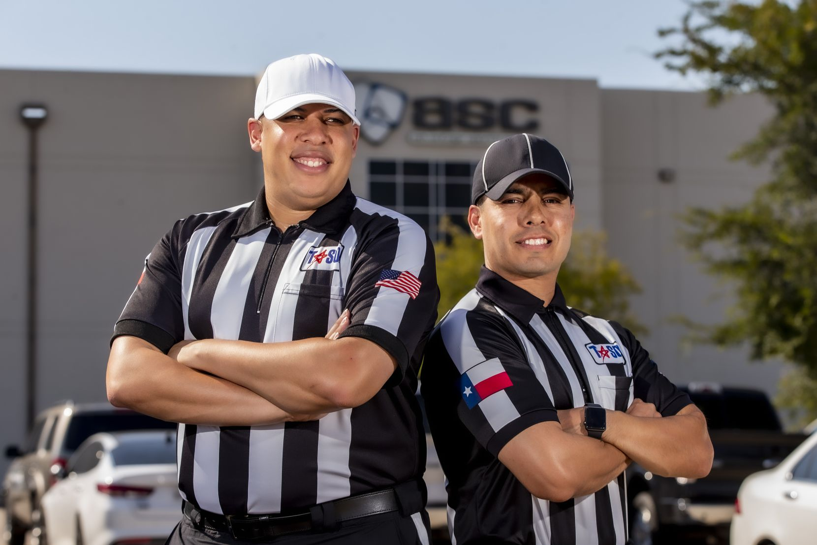 Rickey Herron II, President of the Dallas Football Officials Association, left, and Xavier Velazquez, a head linesman, pose for a photo outside of the Advantage Sports Complex in Carrollton, Saturday, August 22, 2020. There is a shortage of officials for high school football.
