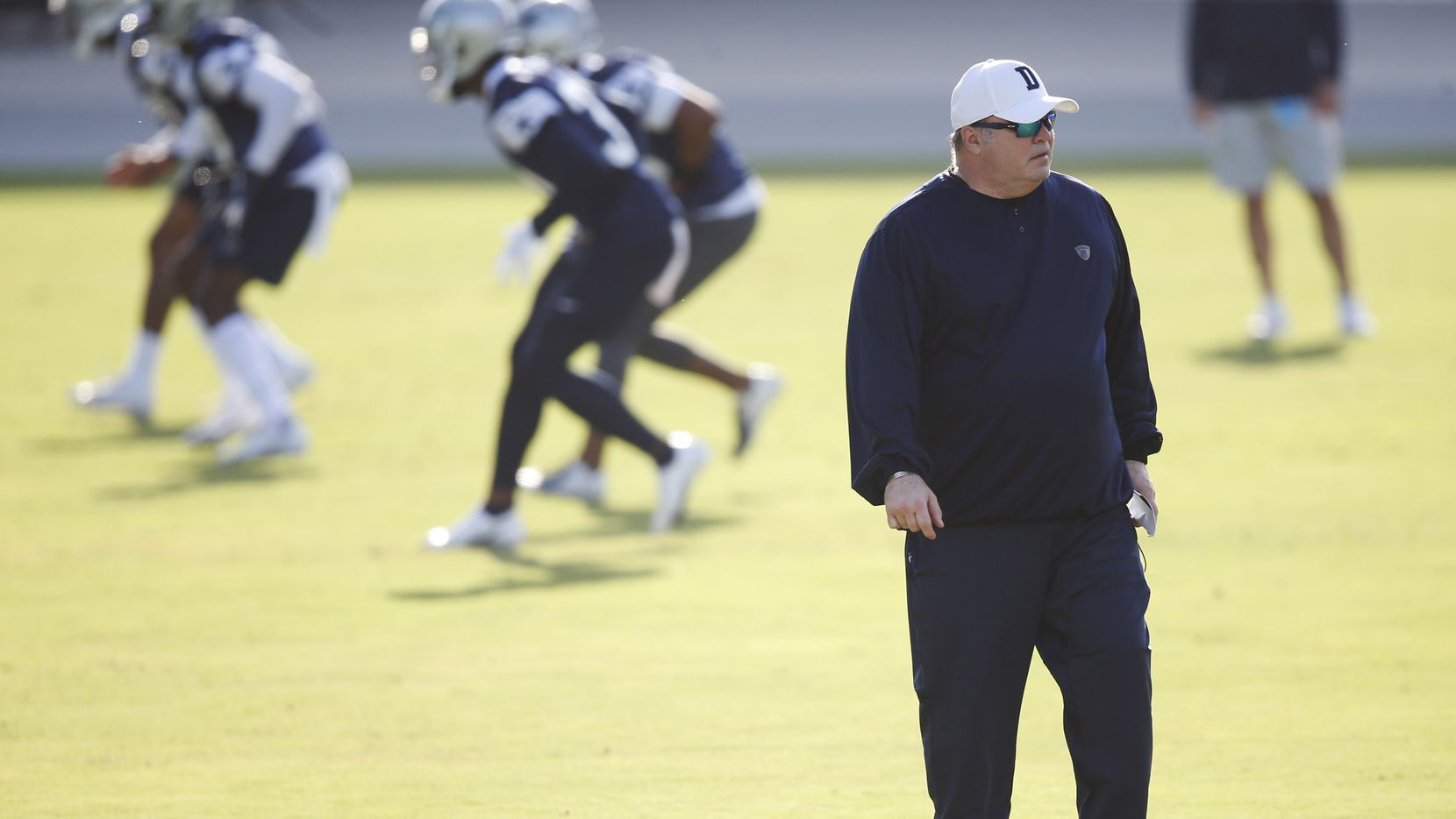 FILE - Cowboys head coach Mike McCarthy watches practice on the first day of training camp at The Star in Frisco on Friday, Aug. 14, 2020.