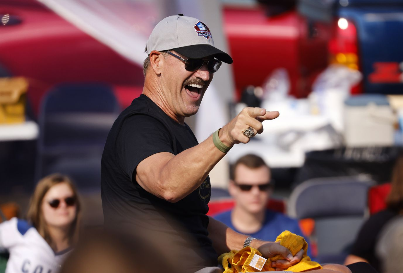 Pittsburgh Steelers Pro Football Hall of Fame inductee Bill Cowher points to his fans as he rides down Cleveland Ave during the Canton Repository Grand Parade in downtown Canton, Ohio, Saturday, August 7, 2021. The parade honored newly elected and former members of the Hall, including newcomers and former Dallas Cowboys players Cliff Harris, Drew Pearson and head coach Jimmy Johnson. (Tom Fox/The Dallas Morning News)