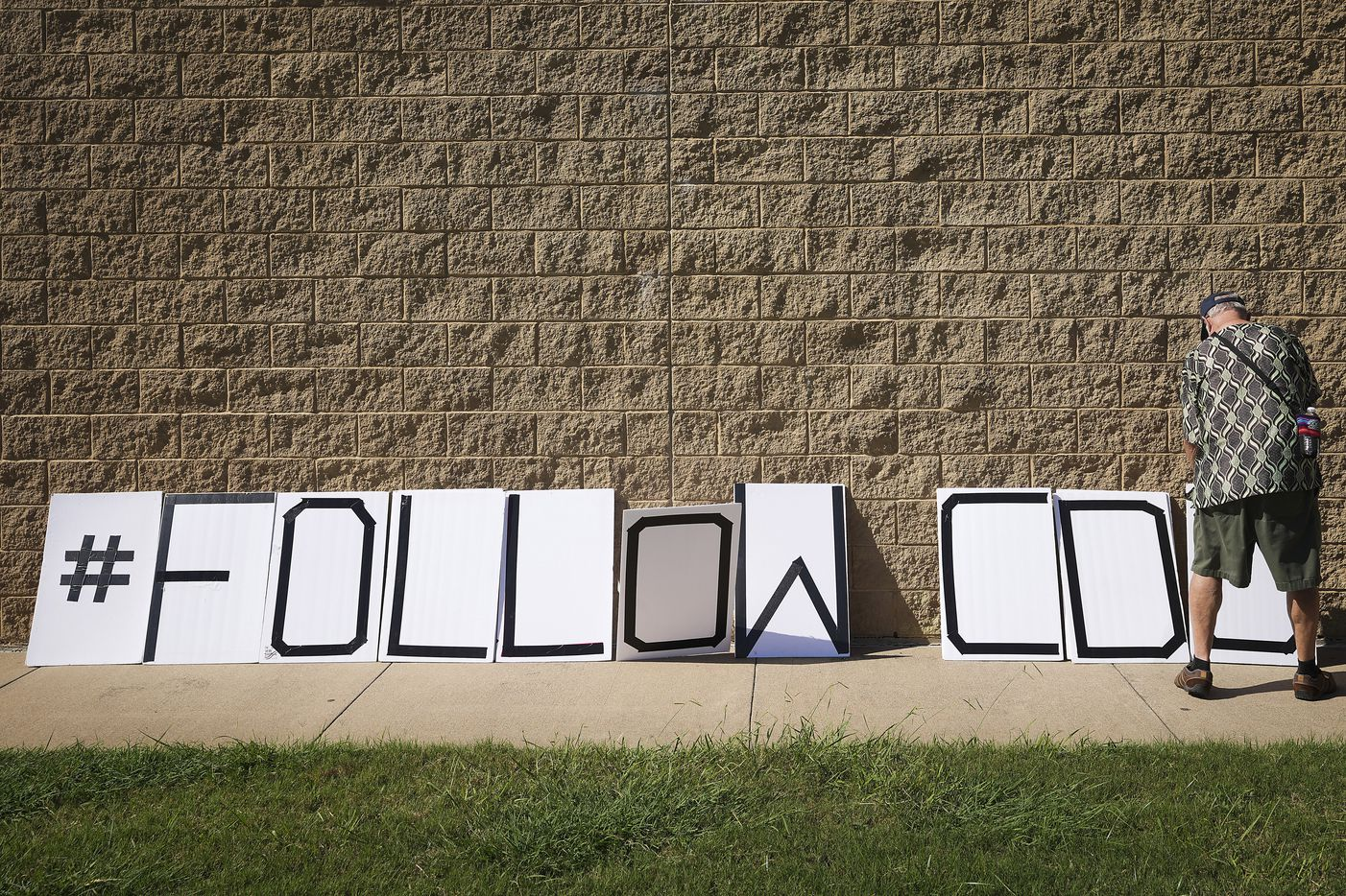 Supporters of mask mandates set out signs outside the Carroll ISD school board meeting on Monday, Aug. 23, 2021, in Southlake, Texas. (Smiley N. Pool/The Dallas Morning News)