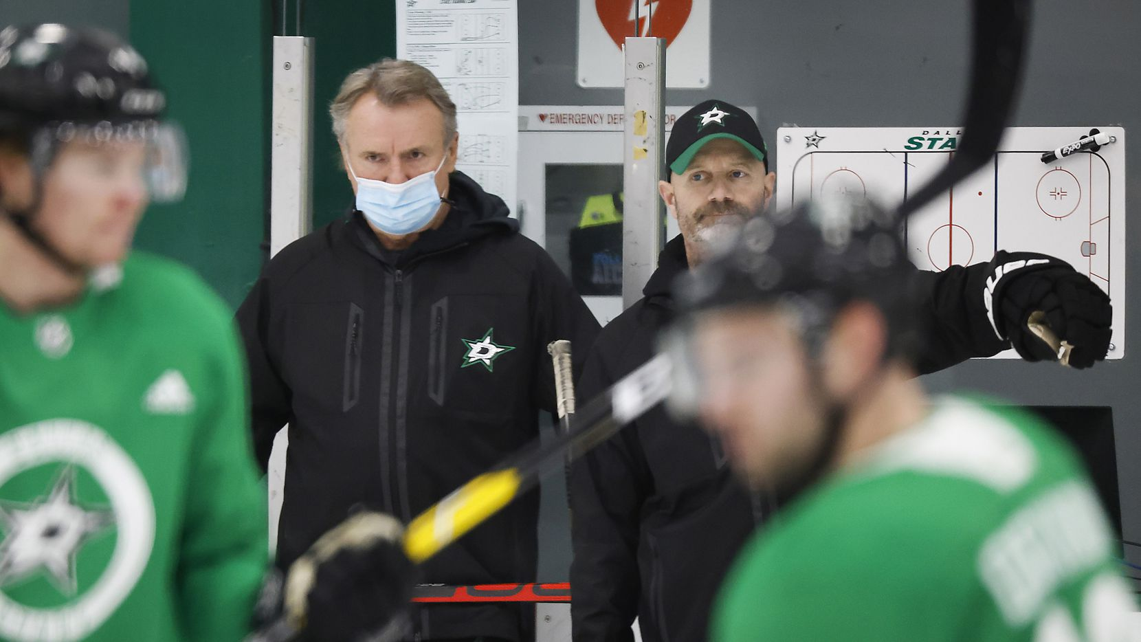 Stars head coach Rick Bowness (with mask) watches his team work out during training camp at Comerica Center on Wednesday, Jan. 6, 2021, in Frisco.