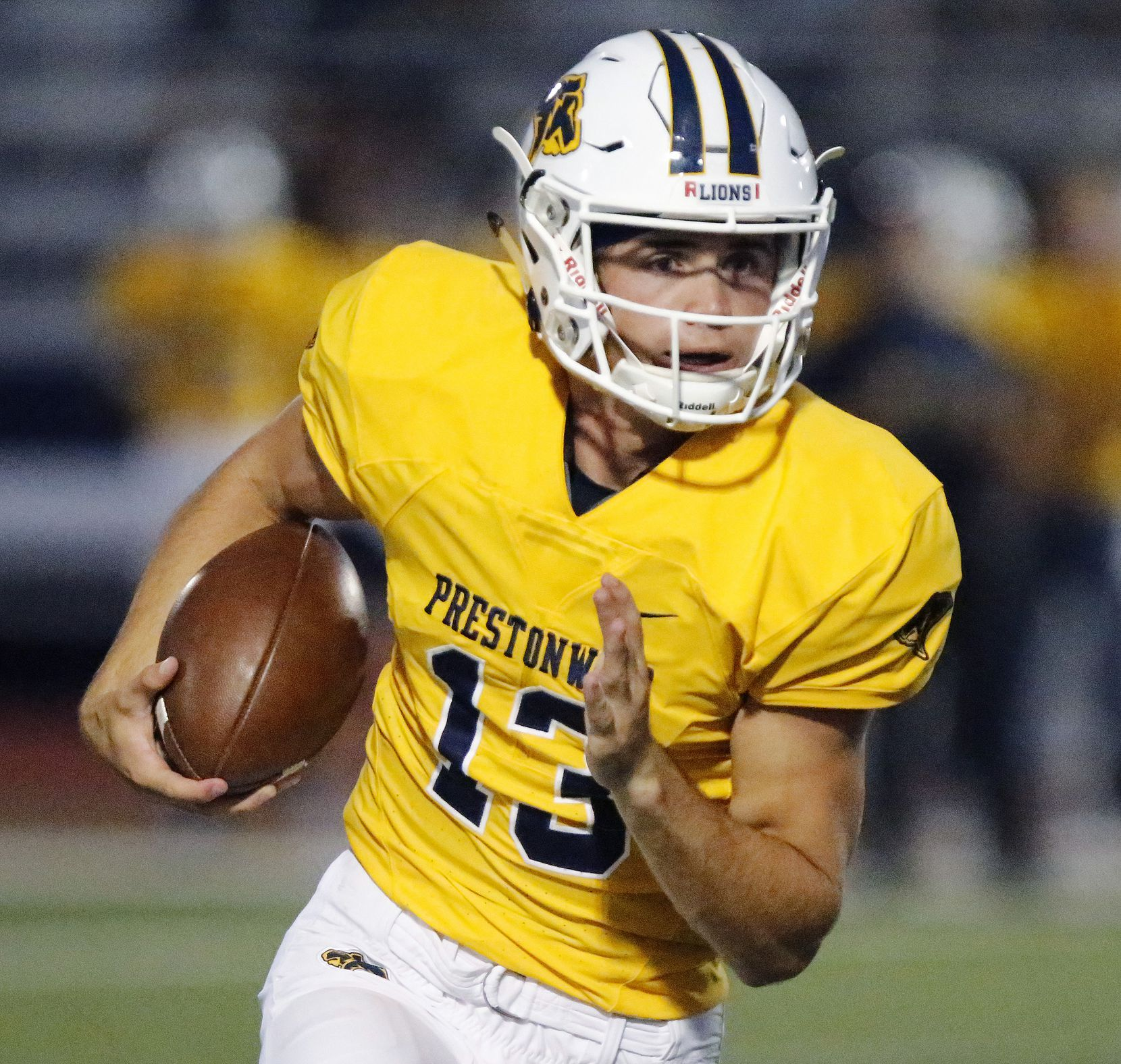 Prestonwood Christian Academy quarterback Maguire Martin (13) carries the ball during the first half as Prestonwood Christian Academy hosted Nolan Catholic High School at Lions Stadium in Plano on Friday night, October 9, 2020. (Stewart F. House/Special Contributor)