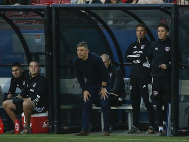 FC Dallas head coach Luchi Gonzalez, center, watches action during the first half of an MLS soccer match between FC Dallas and Philadelphia Union on Saturday, Feb. 29, 2020 at Toyota Stadium in Frisco, Texas.
