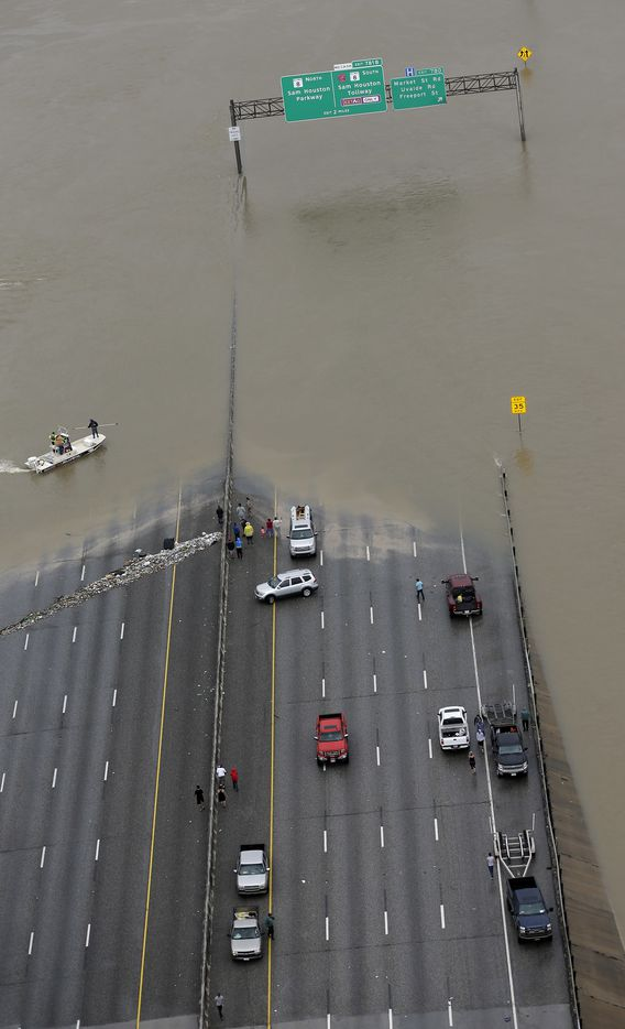Interstate 10 is closed due to floodwaters from Tropical Storm Harvey Tuesday, Aug. 29, 2017, in Houston.