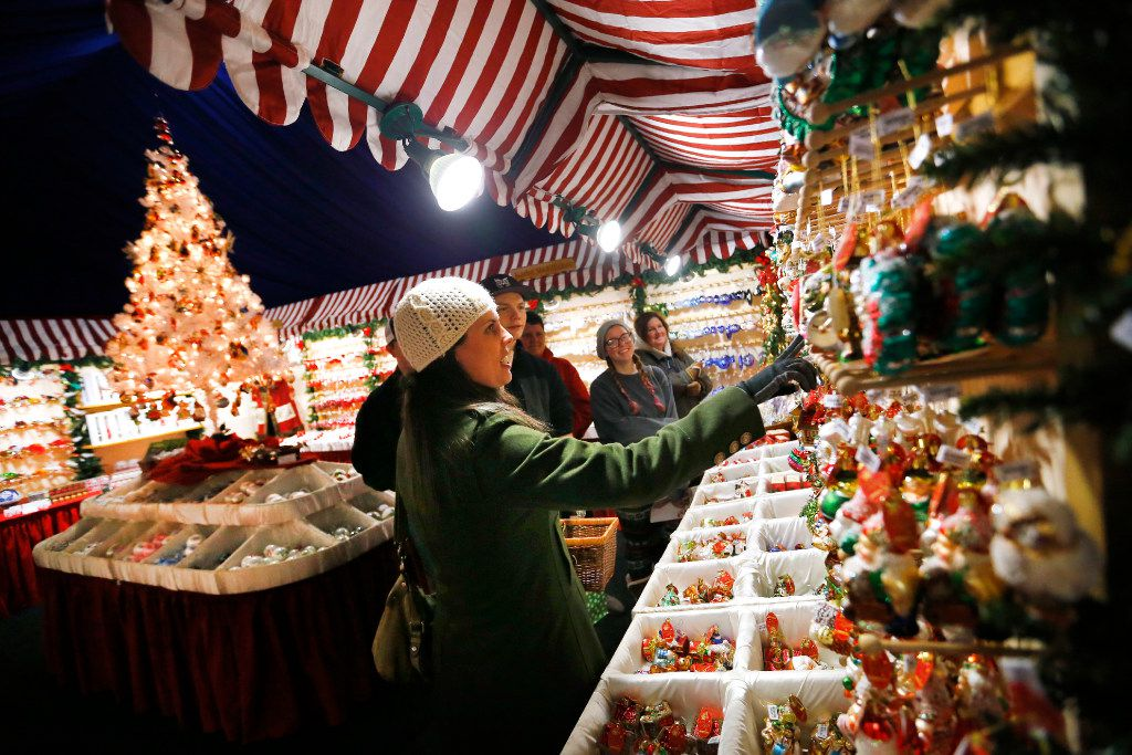 Shoppers check out ornaments made by Käthe Wohlfahrt during the Texas Christkindl Market in Arlington.