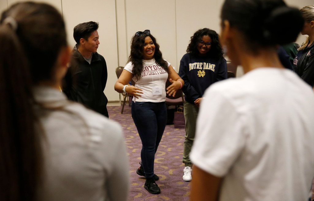 """Charna Kinard (center) shares what she learned about Shanice Cox (right) as Lucas Yoon (left) and others listen during orientation at Fort Worth's new medical school, a collaboration between TCU and UNTHSC. Officials designed the school to focus on """"compassionate practice"""" so that the future doctors will be more empathetic."""