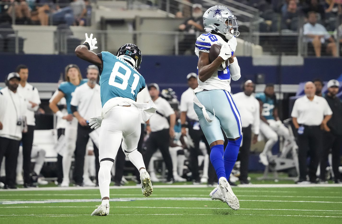 Dallas Cowboys cornerback Israel Mukuamu (38) intercepts a pass intended for Jacksonville Jaguars wide receiver Josh Hammond (81) during the first half of a preseason NFL football game at AT&T Stadium on Sunday, Aug. 29, 2021, in Arlington. (Smiley N. Pool/The Dallas Morning News)