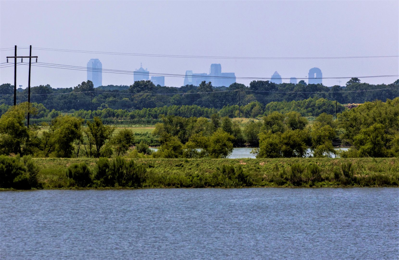 The Dallas skyline is seen form a levee at at the Dallas Southside Water Treatment facility near Sandbranch.