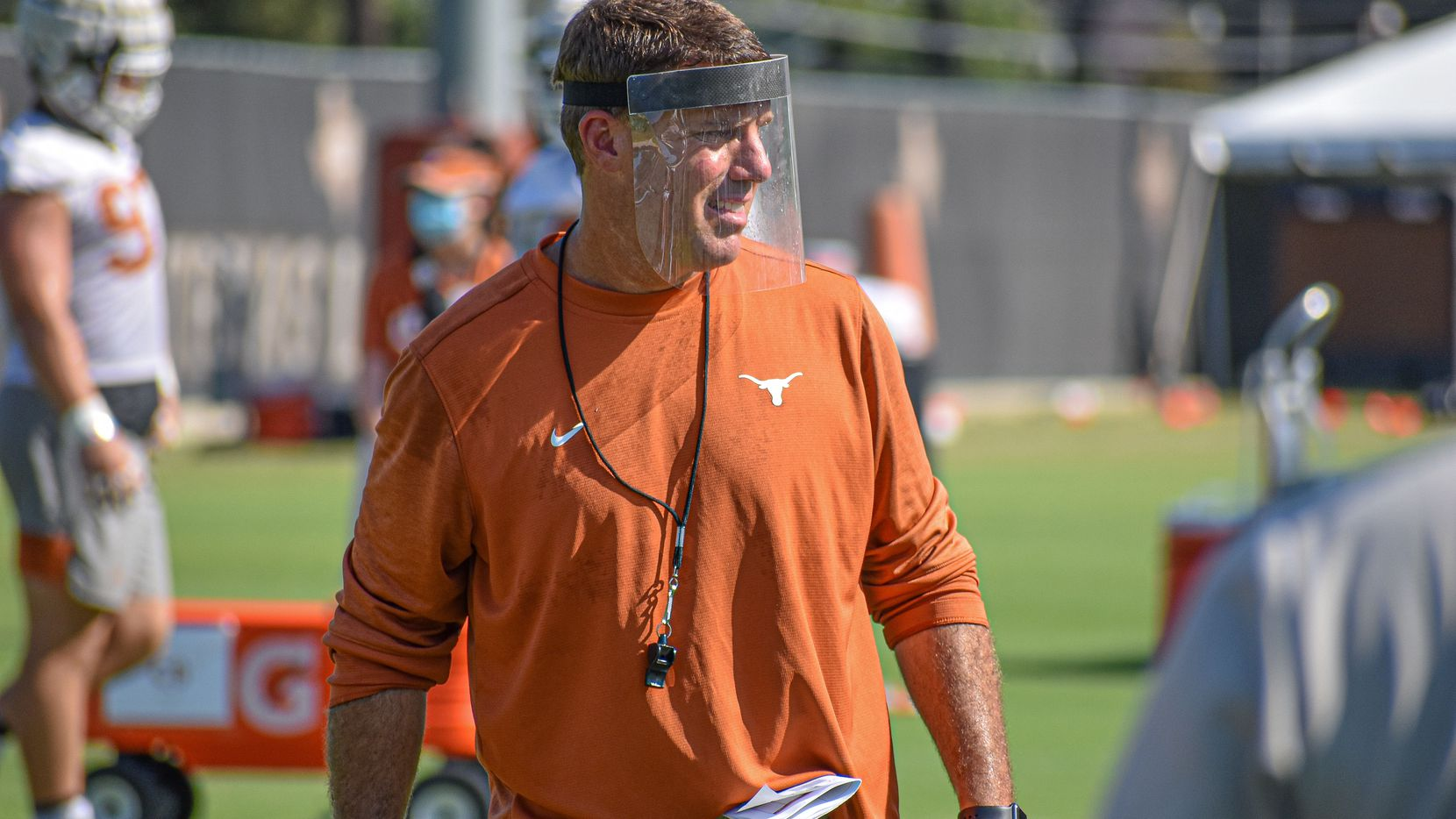 Texas offensive coordinator Chris Ash instructs his players during a practice before the 2020 season.