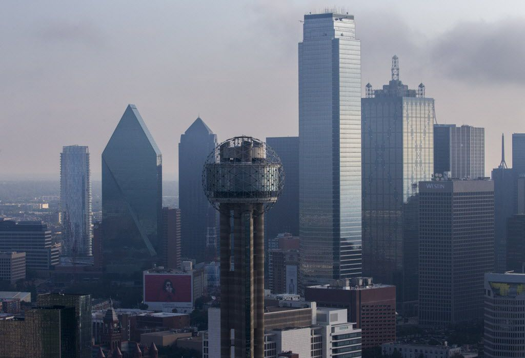 Reunion Tower and downtown Dallas, including the Bank of America Tower (center right) and Fountain Place (second from left).