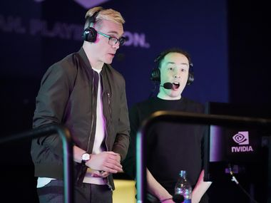 Announcers Brennon Hook (left) and Josh Wilkinson call a Overwatch League match between the Dallas Fuel and the Los Angeles Valiant at the Arlington Esports Stadium on Saturday, Feb. 8, 2020, in Arlington.