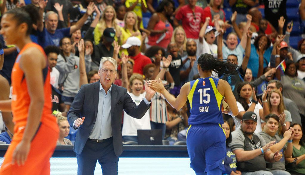 Dallas Wings head coach Brian Agler congratulates Wings guard Allisha Gray (15) as she receives a thundering ovation from fans after making 2 free throws in the waning seconds of their game against the Connecticut Sun to seal a 74-73 victory for the Wings. The two teams played their WNBA game at UT-Arlington's College Park Center in Arlington on June, 26, 2019.  (Steve Hamm/ Special Contributor)