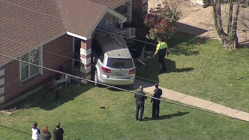 The SUV wound up crashing into a house on Meadowbrook Drive in Fort Worth on Tuesday, March 23, 2021.