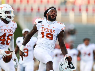 LUBBOCK, TEXAS - SEPTEMBER 26: Defender Joseph Ossai #46 and tight end Malcolm Epps #19 of the Texas Longhorns celebrate after what they thought was a game ending fumble recovery during overtime of the college football game on September 26, 2020 at Jones AT&T Stadium in Lubbock, Texas.