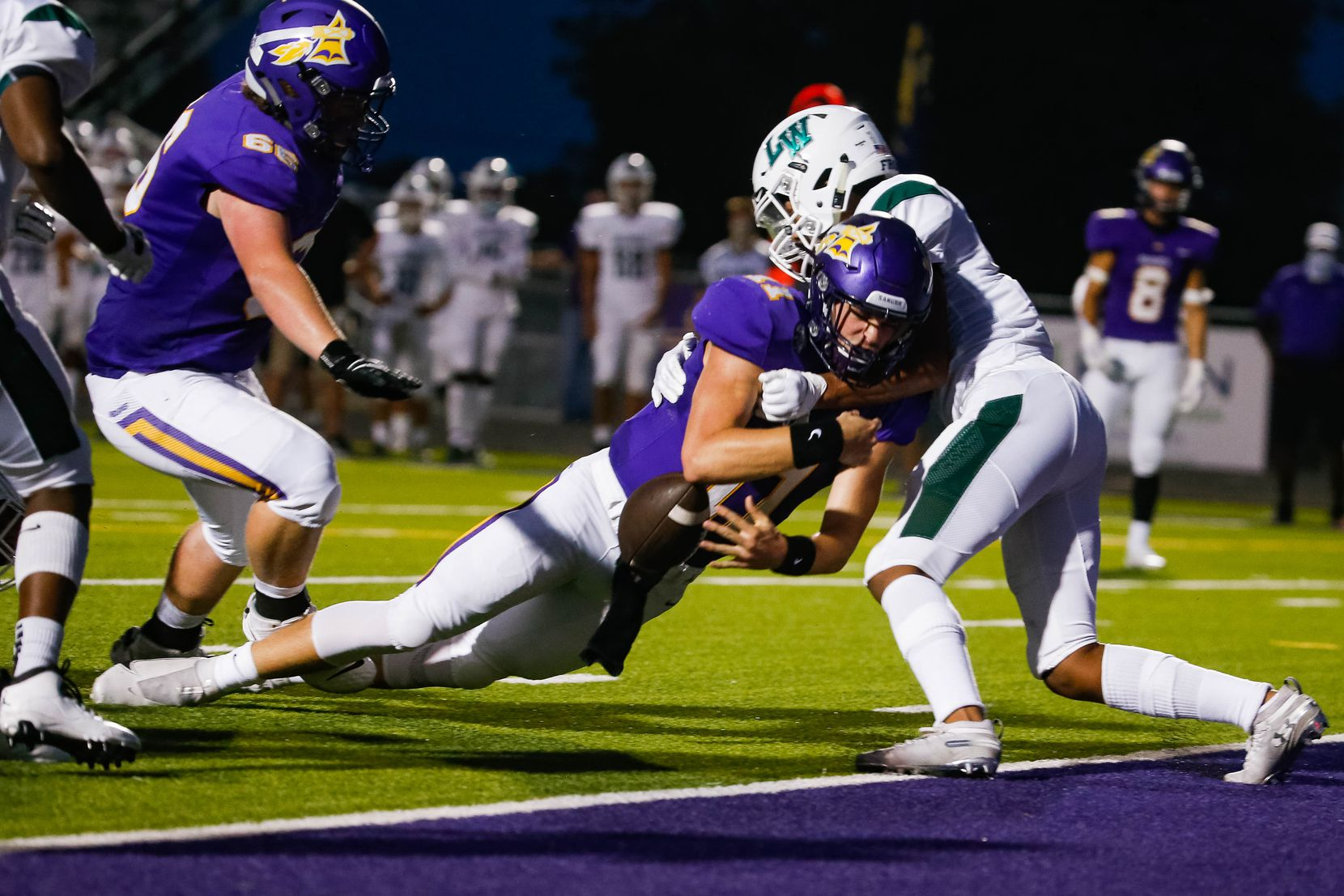 Sanger High School player Rylan Smart is tackled before the goal line by Lake Worth High School's defense during the first half of a game on Sept. 4, 2020 in Sanger.  Sanger leads 26-14 at halftime. (Juan Figueroa/ The Dallas Morning News)