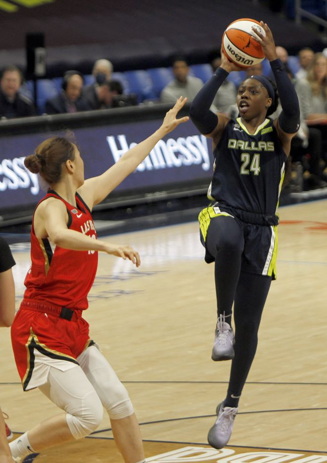 Dallas Wings guard Arike Ogunbowale (24) puts up a jump shot over the defense of Las Vegas center JiSu Park (19) during second half action. Las Vegas defeated Dallas 95-79. The two WNBA teams played their game at College Park Center on the campus of UT-Arlington on July 11, 2021. (Steve Hamm/ Special Contributor)