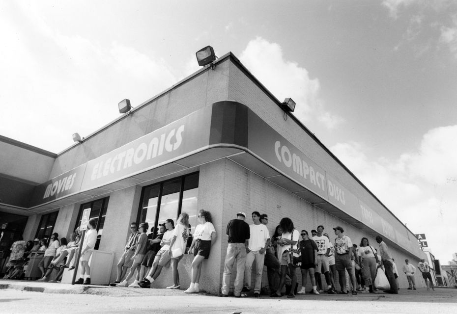 July 11, 1992: A line  snakes around the Sound Warehouse at 5475 Greenville Ave. as fans wait to buy tickets for the Lollapalooza '92 concert.