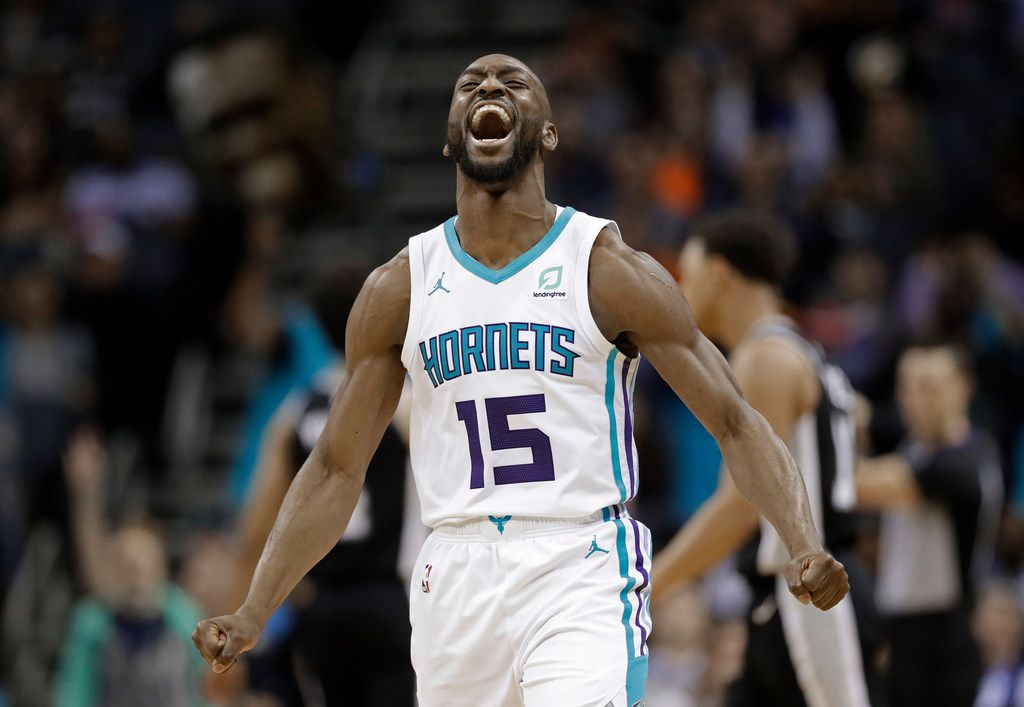 Charlotte Hornets' Kemba Walker (15) reacts after making a basket against the San Antonio Spurs during the second half of an NBA basketball game in Charlotte, N.C., Tuesday, March 26, 2019. (AP Photo/Chuck Burton)