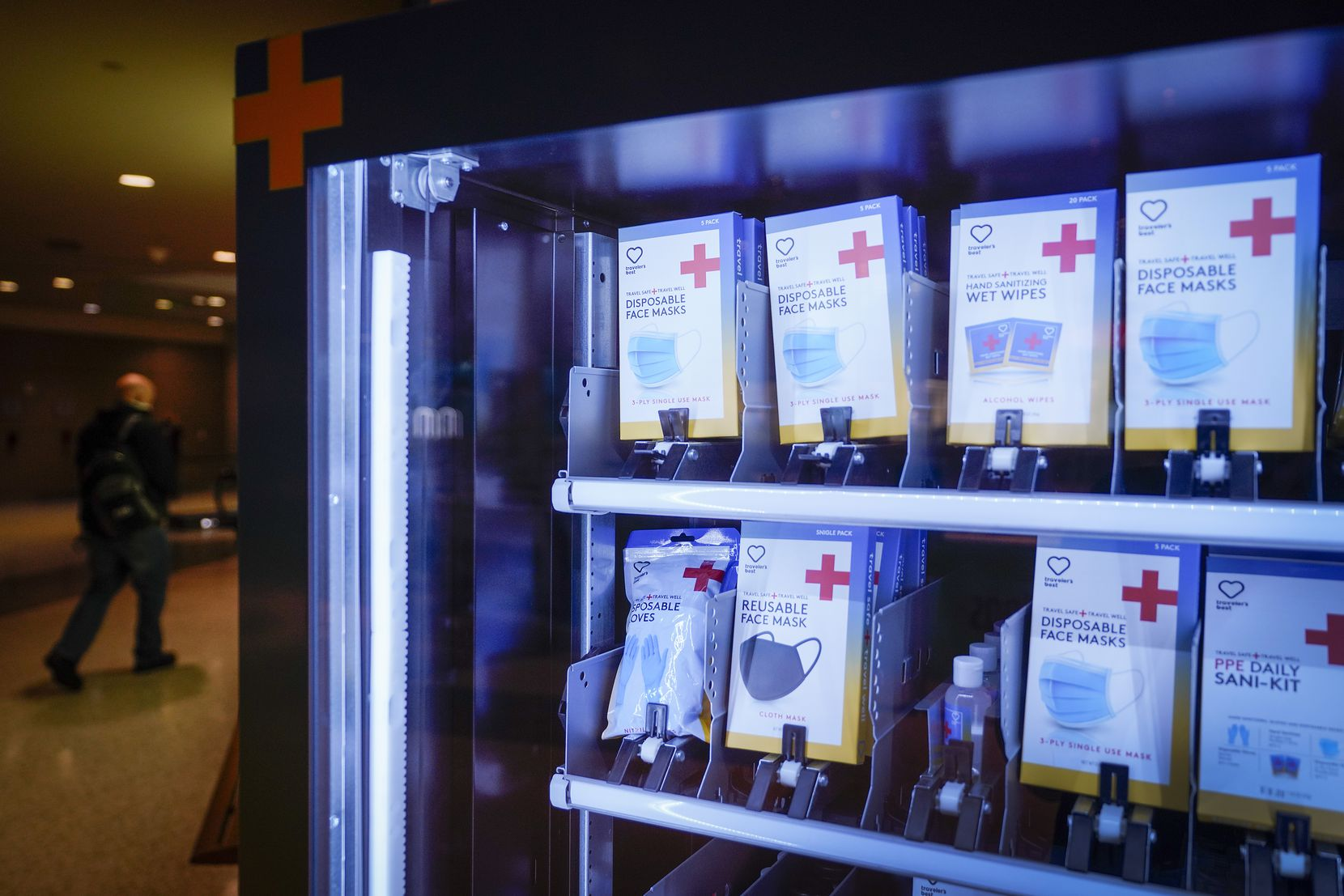 Masks, sanitizing wipes and other PPE are available for sale at a vending machine at Dallas Love Field on Thursday, Jan. 7, 2021, in Dallas. (Smiley N. Pool/The Dallas Morning News)
