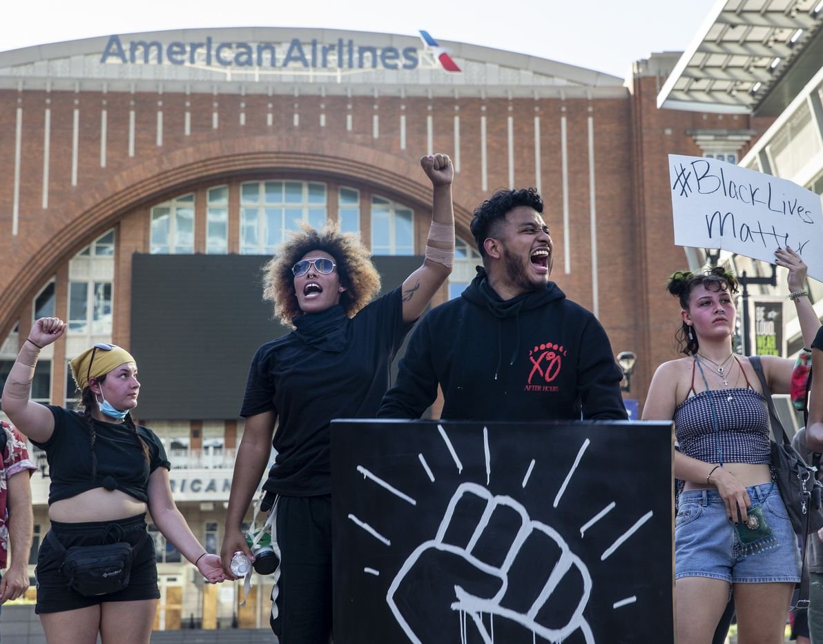 Miguel Ibarra (center right) shouts with other protesters during a demonstration at the American Airlines Center to denounce police brutality and systemic racism in Dallas on Thursday, June 4, 2020. The demonstration took place on the seventh consecutive day of organized protests in response to the recent deaths of George Floyd in Minneapolis and Breonna Taylor in Louisville.