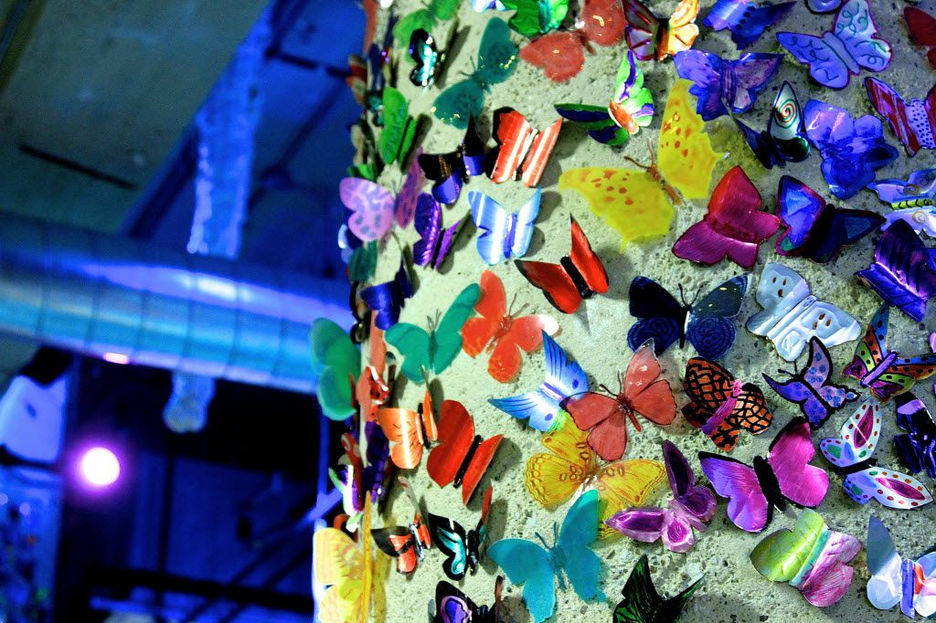 Thousands of soda-can butterflies adorn the tops of columns in the gallery level of SPARK! Adventures in Creativity in Dallas. They are bright reminders of the many volunteers who have contributed to SPARK!, and everyone who visits the space is invited to add their own to the space.