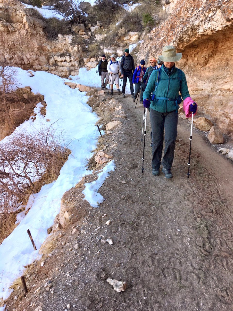 Lane Transou (front) carefully navigates the Bright Angel trail in Grand Canyon National Park. She was there with her two sisters to celebrate the milestone birthday of her sister Lynda, who was right behind her in this photo.