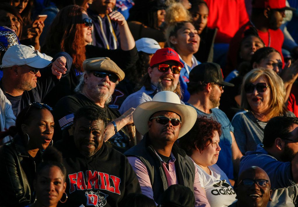 Duncanville fans watch a replay during the second half of a Class 6A Division I state semifinal football matchup between Rockwall and Duncanville on Saturday, Dec. 14, 2019 at McKinney ISD Stadium in McKinney, Texas. (Ryan Michalesko/The Dallas Morning News)
