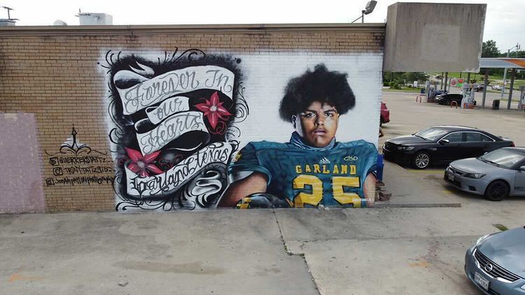 With the help of donations from Garland residents, muralist Juan Velazquez touched up and fixed the defaced mural of late Garland high school football player Christopher Guardado. The mural is located outside Trendsetters Barber and Beauty Salon.