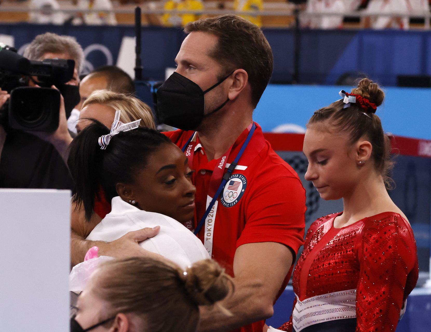 USA's Simone Biles hugs coach Laurent Landi after returning to the field of play shortly after competing in the vault during the artistic gymnastics women's team final at the postponed 2020 Tokyo Olympics at the Ariake Gymnastics Centre on Tuesday, July 27, 2021, in Tokyo, Japan. Biles was pulled from competition after the vault.