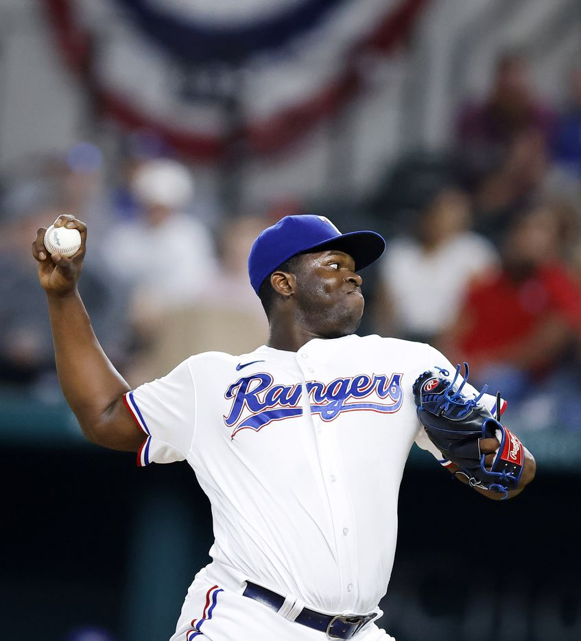 Texas Rangers relief pitcher Jharel Cotton (45) throws against the Oakland Athletics during the ninth inning at Globe Life Field in Arlington, Saturday, August 14, 2021.(Tom Fox/The Dallas Morning News)