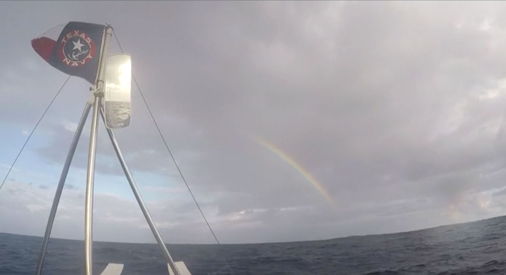 A rainbow appeared in a gray sky over the team as it rowed across the ocean.